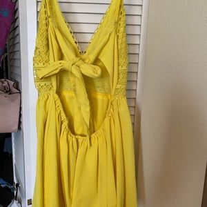 Yellow romper with tie back